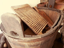 Old washing method. Old washing method, old wooden trough with washboard Royalty Free Stock Photo