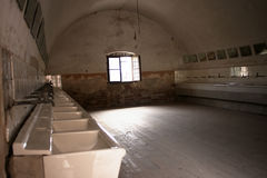 An old washroom in a concentration camp. An old personal hygiene washroom in a concentration camp Royalty Free Stock Photography