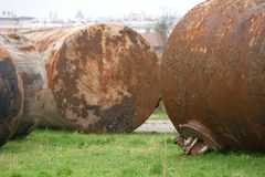 Old waste tanks. On a field royalty free stock photo