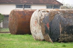 Old waste tanks. On a field stock photos