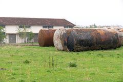 Old waste tanks. On a field royalty free stock photos