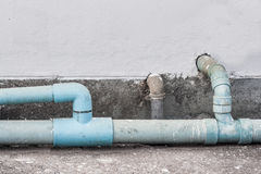 Old waste water pipe. On wall background Stock Images