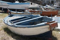Old boats on the sand stock image