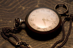Old watch #4. An old pocket watch on a book stock photos