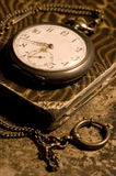 Old watch. An old pocket watch on a book royalty free stock image