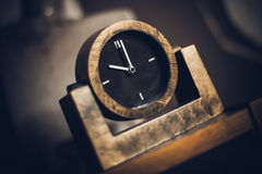 Old watch with a black dial. Stock Photo