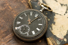Old watch on the book Royalty Free Stock Images