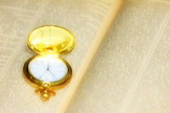 Old watch and book Royalty Free Stock Images