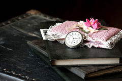 Old watch and books Stock Images