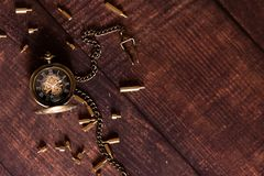 Old watch with details on a brown background.  royalty free stock images