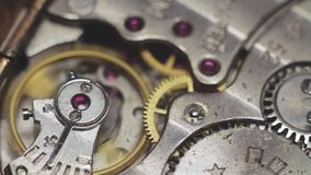 Old watch gears very close up. Clockwork stock video footage
