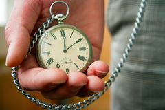 Old Watch in Hand. Person holding old pocket watch in his hand Stock Images