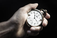 Old watch in hand Stock Image
