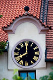 Old watch on a house roof. In Prague, the Czech Republic stock photo