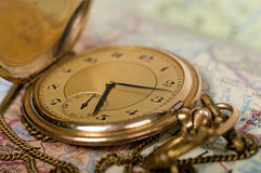 Old watch on map. Photo of old watch on map stock images