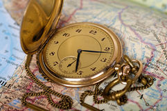 Old watch on map. Photo of old watch on map royalty free stock images