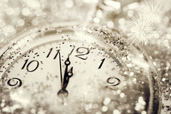 Old watch pointing midnight - New Year concept. New Year's at midnight - Old watch with stars, snowflakes and holiday lights royalty free stock image