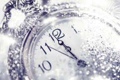 Old watch pointing midnight - New Year concept. New Year's at midnight - Old watch with stars, snowflakes and holiday lights royalty free stock images