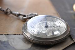 Old watch on the  post card and photo Royalty Free Stock Photos
