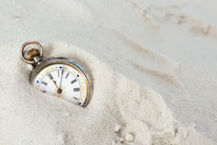 Old watch in the sand Stock Photography