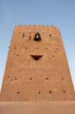 Old watch tower. With smiley face stock photo