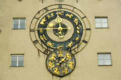 Old watch with zodiac signs. Old watch decorated with zodiac signs at the building. The concept of the zodiac originated in Babylonian astrology, and was later stock image