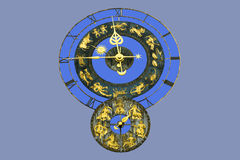 Old watch with zodiac signs. Old german tower watch decorated with zodiac signs at the building. The concept of the zodiac originated in Babylonian astrology Stock Image