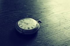 Old watches. Old pocket watches on the wooden desk Stock Photos