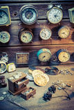 Old watchmaker's room with clocks to repair. Closeup of old watchmaker's room with clocks to repair royalty free stock images