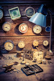 Old watchmaker's room with damaged clocks. Closeup of old watchmaker's room with damaged clocks royalty free stock photography
