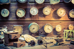 Old watchmaker's room full of clocks Stock Photos