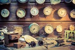 Old watchmaker's room full of clocks. Closeup of old watchmaker's room full of clocks stock photos