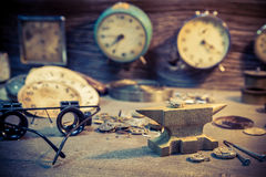 Old watchmaker's room with many clocks. Closeup of old watchmaker's room with many clocks royalty free stock photo