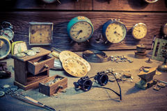 Old watchmaker's room with parts of clocks. Closeup of old watchmaker's room with parts of clocks royalty free stock images