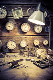 Old watchmaker's workshop with damaged clocks. Closeup of old watchmaker's workshop with damaged clocks royalty free stock images