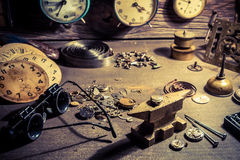 Old watchmaker's workshop full of clocks. Closeup of old watchmaker's workshop full of clocks royalty free stock photos