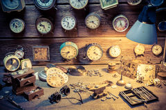 Old watchmaker's workshop with many clocks. Closeup of old watchmaker's workshop with many clocks stock images