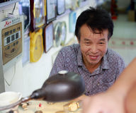 Old watchmaker smiling after repairing Stock Image