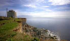 Old watchtower on cliff Stock Image