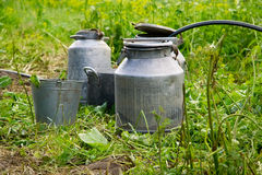 Old water bucket and can Stock Photo