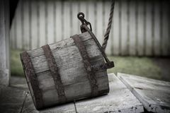 Old water bucket sitting on water well in Williamsburg Virginia stock photography