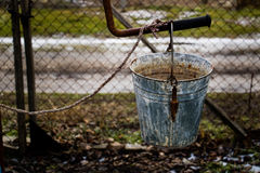 Old water bucket in the village. Near Varna Bulgaria Stock Photography
