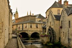 Old city of Bayeux in France. Old water canal in city of Bayeux in Normandy, France Royalty Free Stock Photo