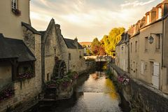 Old water canal in Bayeux. Old water canal with water wheel in Bayeux, Normandy, France Royalty Free Stock Images