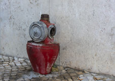 Old water hydrant. Old red fire water hydrant in the city of Lisbon, the capital of Portugal Stock Image
