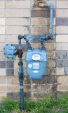 Old water meter. Outside a brick building Royalty Free Stock Photography