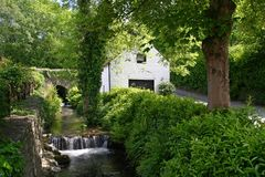 Old water mill. Romantic old mill near Avoca, Ireland Stock Photos