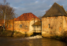 Old water mill building. This mill is located in Grobbendonk, Belgium. It dates back to the 11th century and was owned by the Lords of Grobbendonk and the Dukes Stock Photo