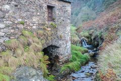 The old water mill!. The old water mill contemplates the beginning of autumn next to his friend the little river Royalty Free Stock Image