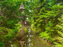 Old water mill in the forest.  Royalty Free Stock Photography